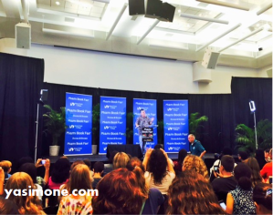 Rick Riordan speaking to a roomful of fans.
